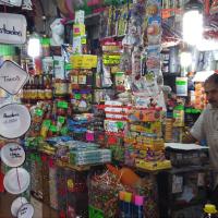 Man selling wares at open market