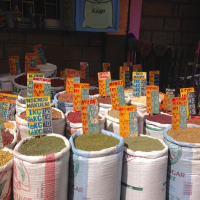 cilendars of bulk grains and rice with price tags attached