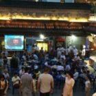People walking around at night food market