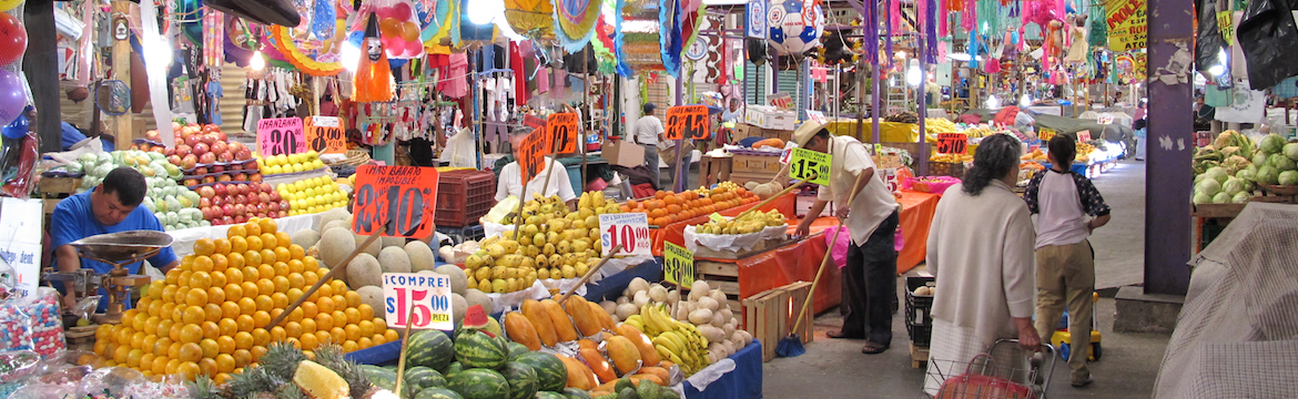 Fruit market with shoppers in Mexico City